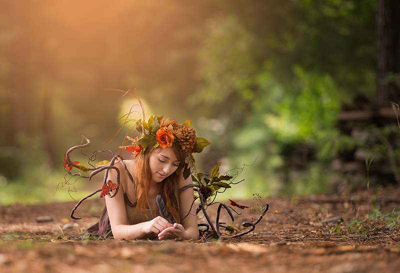a fairy writes with a bird feather