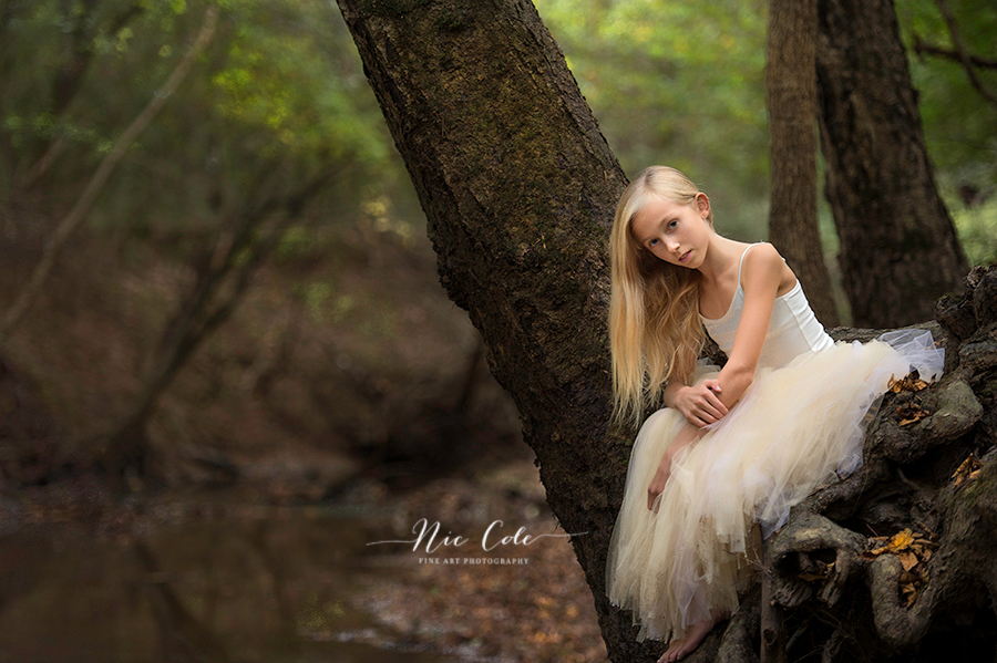 teenager in a tree with tutu