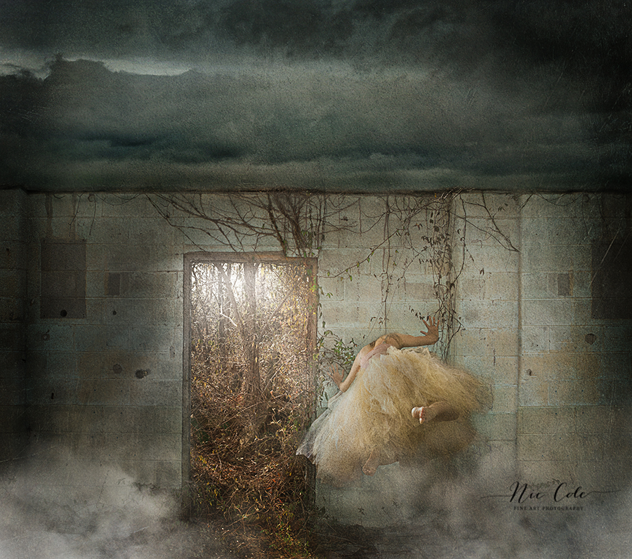 Conceptual photo of ladies head in a wall