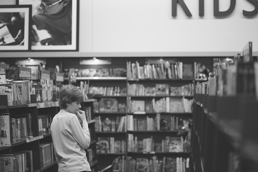 Boy looking for book