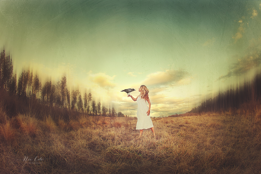 A conceptual image of girl and bird