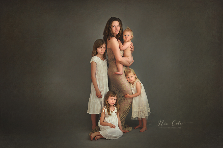 beautiful mother with her four young girls