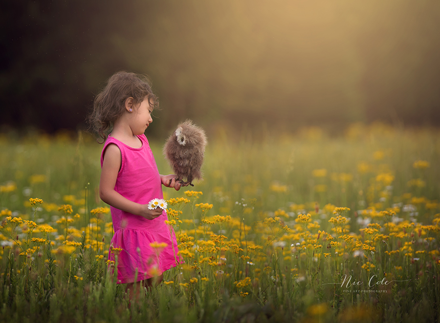 little girl taking to owl