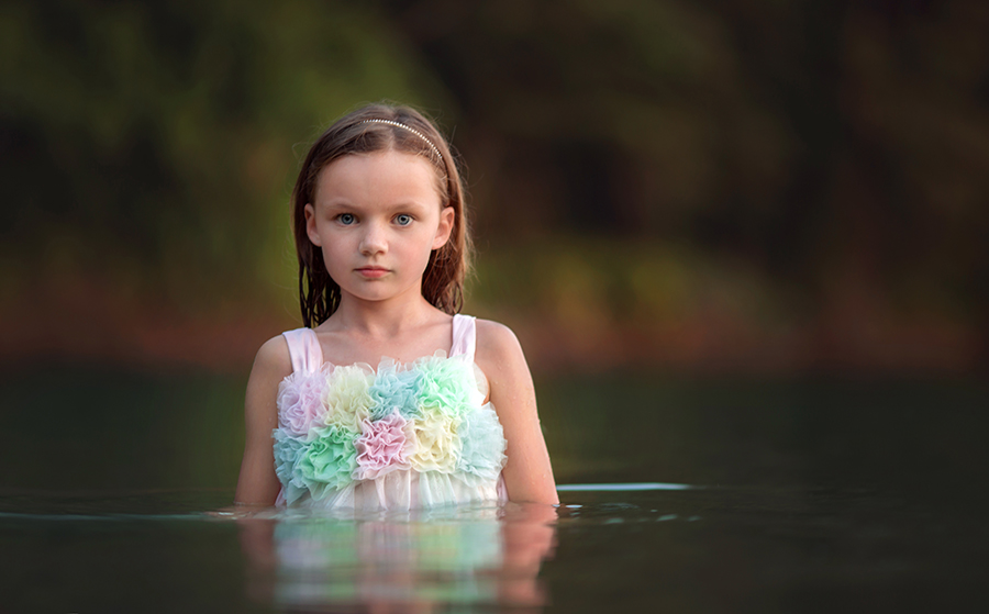 Fine art image in lake of girl