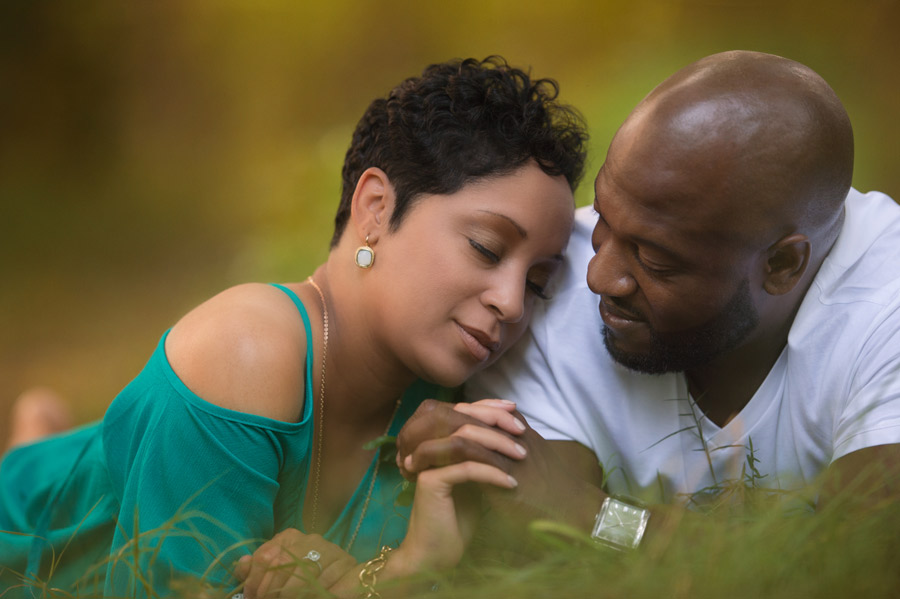 Charlotte-baby-photographer-couple-sitting-in-NC-field