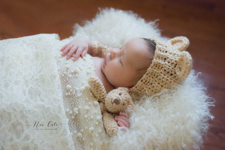 nfant-sleeping-with-bear-toy-charlotte-baby-photographer